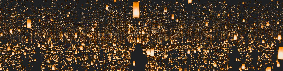 Abstract photo with lots of orange lamps reflecting in mirrors
